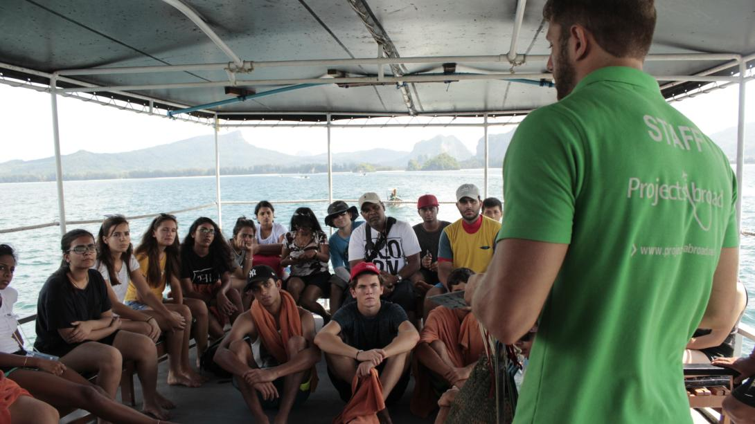 Projects Abroad staff member runs volunteers through safety procedures in Thailand.